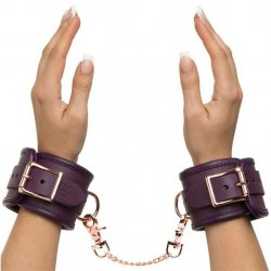 Fifty Shades Freed: Cherished Collection Leather Wrist Cuffs Purple With Gold Color Chain sex toy from Lovehoney.