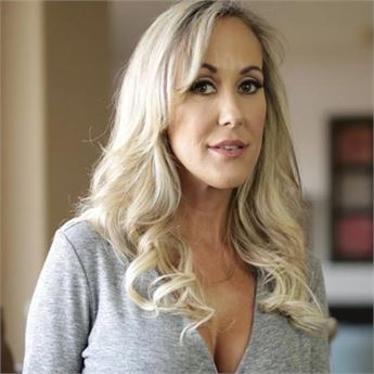 Beautiful blonde Brandi Love is pictured in a plunging grey top.